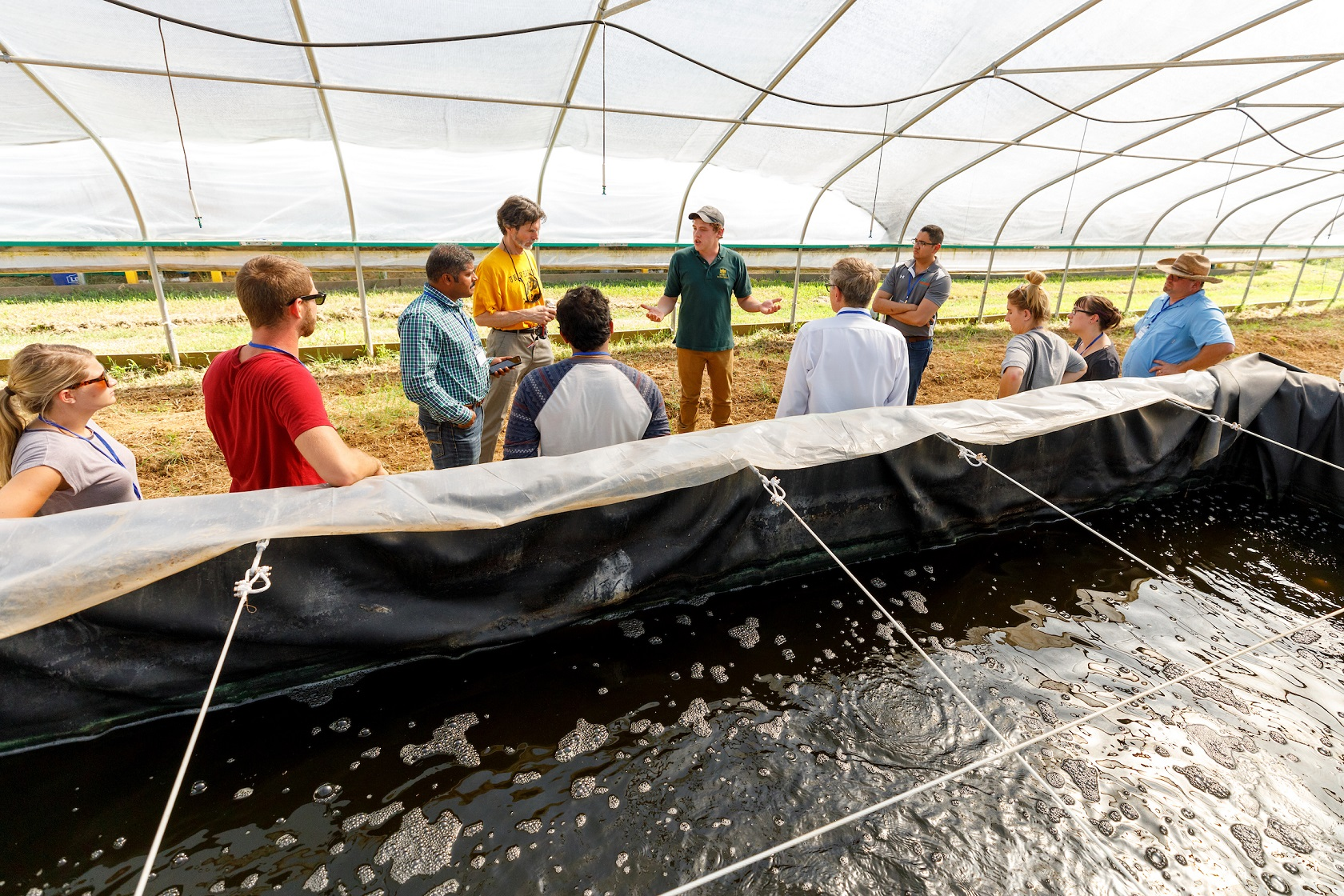 FRANKFORT, Ky., -- Nathan Kring Kentucky State University aquaculture students give tours of the High Tunnels on campus that house hemp, and marine shrimp as part of a shrimp farming workshop, Friday, Sept. 14, 2018 at the Harold R. Benson Research and Demonstration Farm in FRANKFORT.