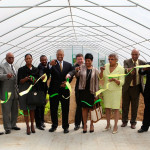 Members of KSU's Board of Regents cut the ribbon to open KSU's new Campus High Tunnel complex.