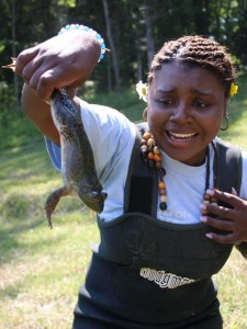 Girl holding a frog