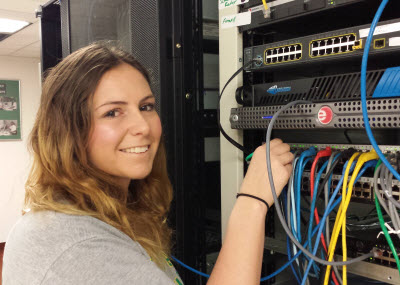 A KSU student working on a server cluster in the Office of Information Technology.