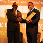 Mr. Reggie Calloway receiving the L2L award from  Dr. Shelton