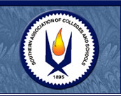 Commision on Colleges of the Southern Association of Colleges and Schools logo looks like a flame in the middle of two inward facing boomerangs that touch