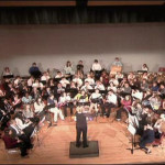 Guest Conductor Paul Schrameck rehearses the Honos Band