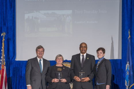 Agriculture Secretary Tom Vilsack and Deputy Agriculture Secretary Krysta Harden present the award to the Third Thursday Team, Kentucky State university, Frankfort, Kentucky at the 2013 Honor Awards in the Jefferson Auditorium at the U.S. Department of Agriculture in Washington, DC, on Wednesday, Dec 11, 2013. USDA photo by Lance Cheung.