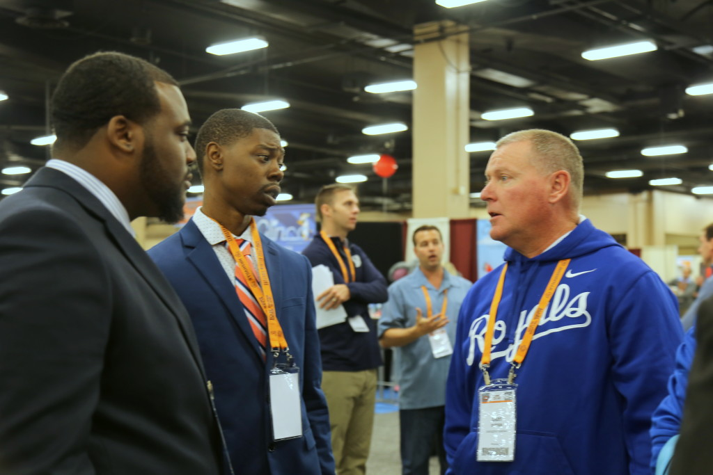 Fredrick Hattaway and Sean Goodwin network with Lexington Legends' Gary Durbin.