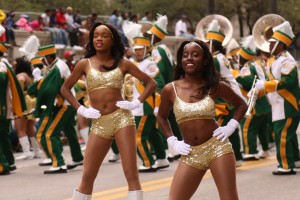 Photograph of Kentucky State University's K'Rette dance team and Marching Band at a football game.