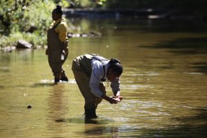 Picture of two girls testing water - Environmental Science and Water Quality