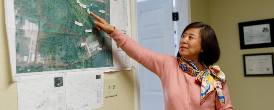 Angie Wu shows plans for a new industrial park at Two Rivers Fisheries Processing Plant in Wickliffe