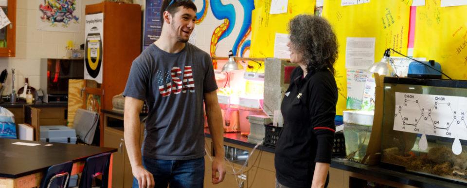 Russellville Senior High student Robert Skipworth left, talks with Aquaculture Teacher Tanya Mullen