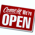 Red and White Come in We're Open Sign